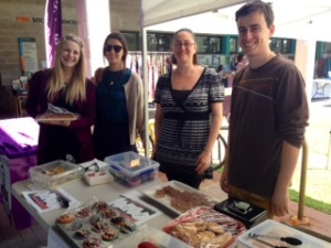 Students at the bake sale to raise money for their performance.