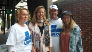 Sarah-Jane Aston - Last minute campaigning at the booths, Liberal candidate Libby Mettam with her husband and two daughters.