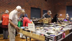 A happy shopper at Save the Children Australia's annual South of the River Book Sale.