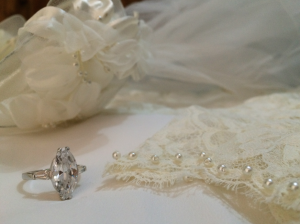 The diamond ring, veil, and elegant beading are all part of a girls dream wedding.