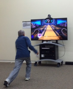 Exergamer in action, playing virtual bowling. Photo by Saskia Tjahja
