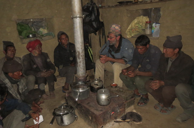 Alex Zahnd (centre-right) sitting with villagers around a new smokeless stove, Nepal, April 2014. Source: RIDS-Nepal