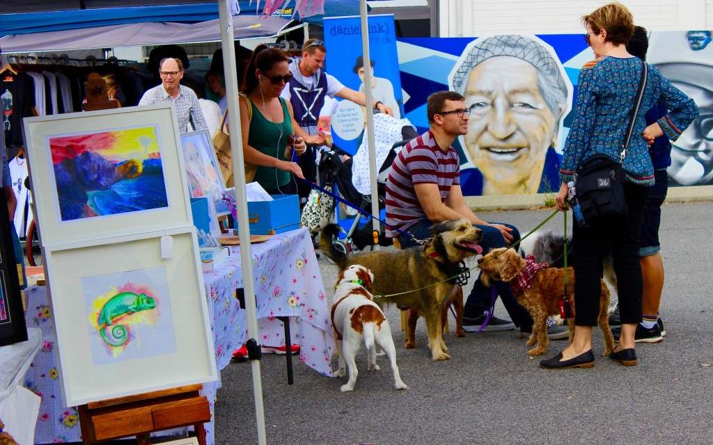 Dogs join in the fun at the Beaufort Street art market.