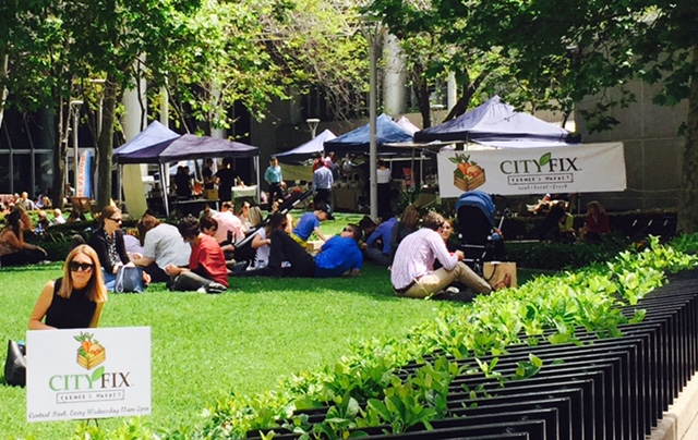 City workers enjoying the sunshine at the City Fix Farmers' Markets.
