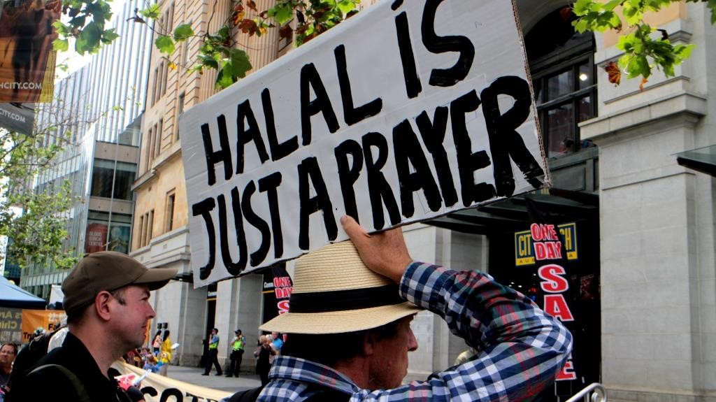 'Halal is just a prayer' – Protesters used handmade signs to help spread their message.