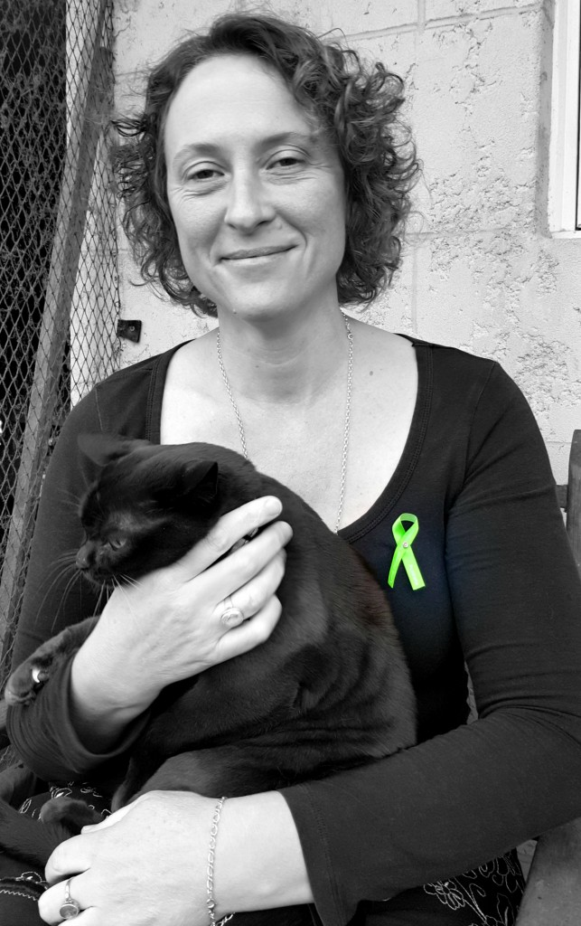 Melinda Stephen wearing the ribbon for Lyme Disease support