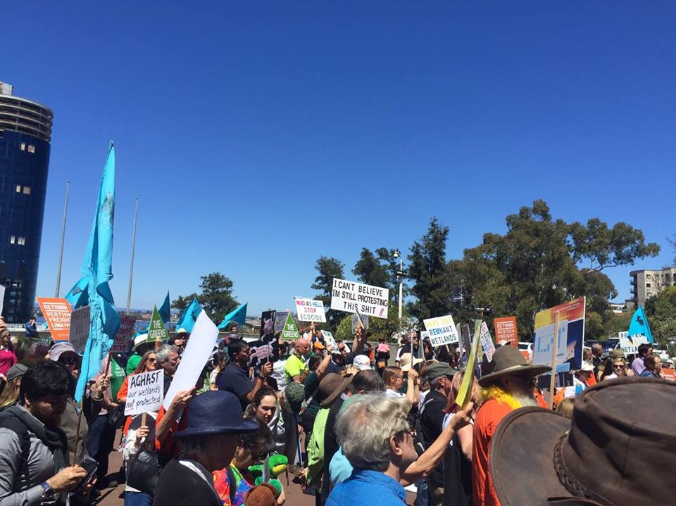Angry protesters at the front of parliament house