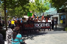 Hundreds 'Walk Together' through the CBD in support of refugees.