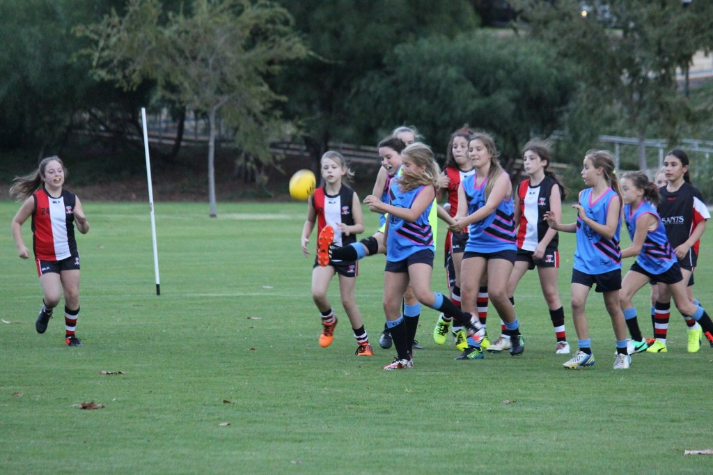 GOAL IN SIGHT: Carine Cats (blue) taking on the Stirling Angels (black) at Grenville Reserve.