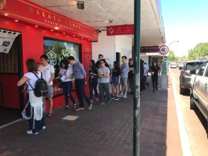 Customers wait for their names to be called outside  Hakata Gensuke on Victoria Park's café strip.