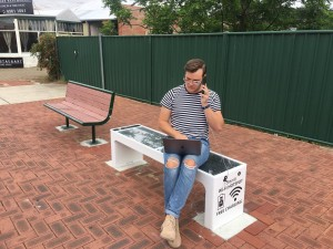 Out with the old and in with the new. Perth's only smart bench offers charging ports and Wi-Fi access.  Pictured: Shane Tapper.