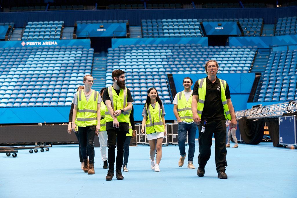 Murdoch students being guided through the Perth Arena workplace following safety procedures. Credit: Photographer Travis Hayto