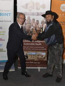 Ben Elton (left) shakes hands with Koodah Cornwall, FISH Aboriginal Elder and Senior Manager (right). Photo courtesty of Mark Anderson.