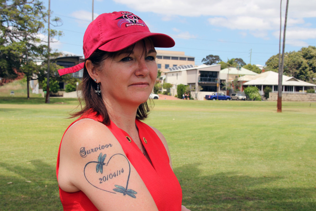 Pam McKenzie proudly shows off her survivor tattoo after suffering a SCAD heart attack three years ago.