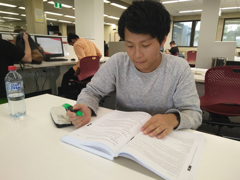 Sho Teramura, studying English texts. Provided by Timothy Leong