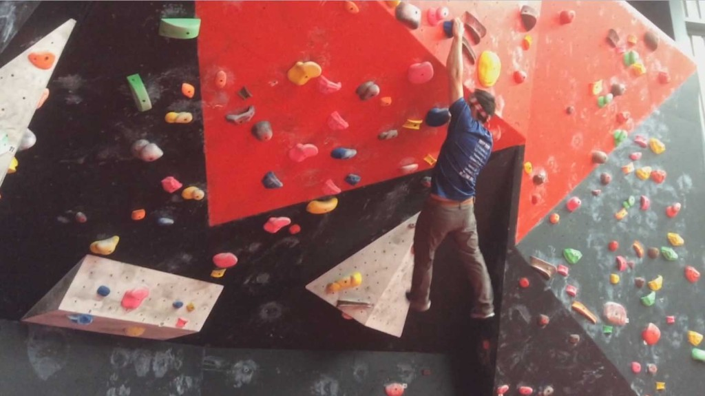 US Ninja Warrior Drew Drechsel plans his approach on a mountain climbing obstacle in practice.